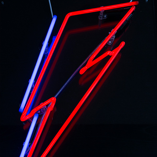 Neon light shape lightning bolt red blue