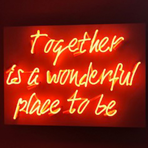 neon light sign home red together is a wonderful place to be