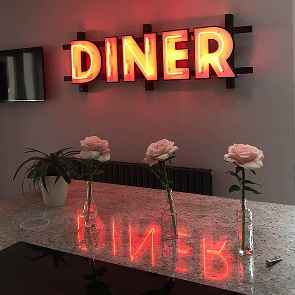 Vintage neon sign Diner orange