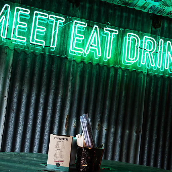 Neon light sign green meet eat drink