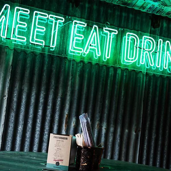 Neon light sign green meet eat drink