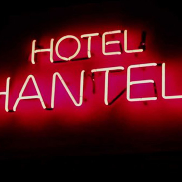 Neon light sign hotel red