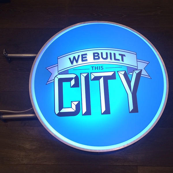 Vintage Lightbox blue We built this city