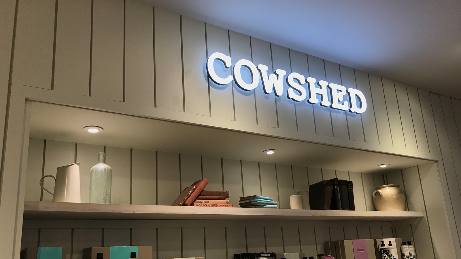 Ultra neon Cowshed logo blue