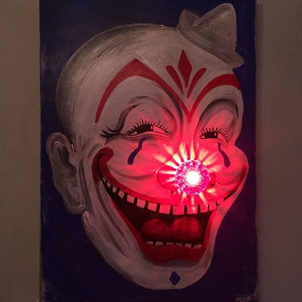 Neon light bulb red nose clown