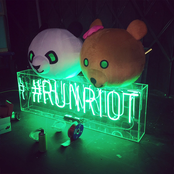 Neon light sign green run riot
