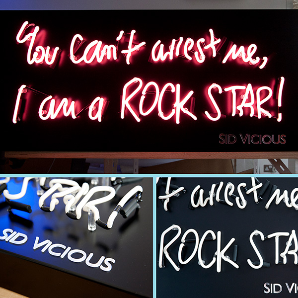 neon light writing you cant arrest me Im a rock star pink