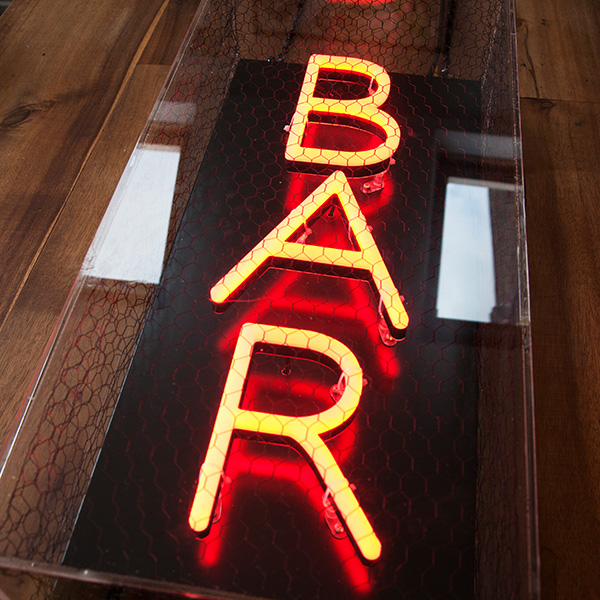 Faux neon light sign red bar