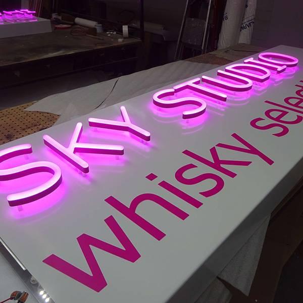 Ultra neon Sky Studio logo pink