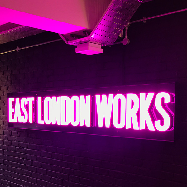 Neon Ultra sign faux neon pink East London Works logo